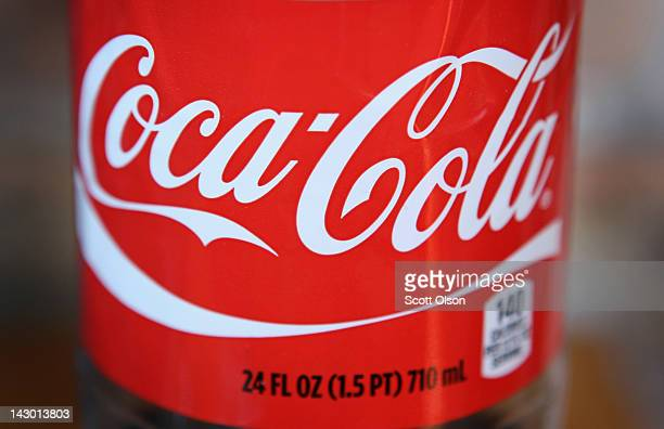 The CocaCola logo is printed on the lanel of a 24ounce bottle of soda on April 17 2012 in Chicago Illinois The CocaCola Co reported an 8 percent...