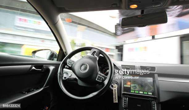 The cockpit of an autonomous driving car run by German company Continental is pictured during a ride over the Frankfurt Auto Show IAA in Frankfurt am...