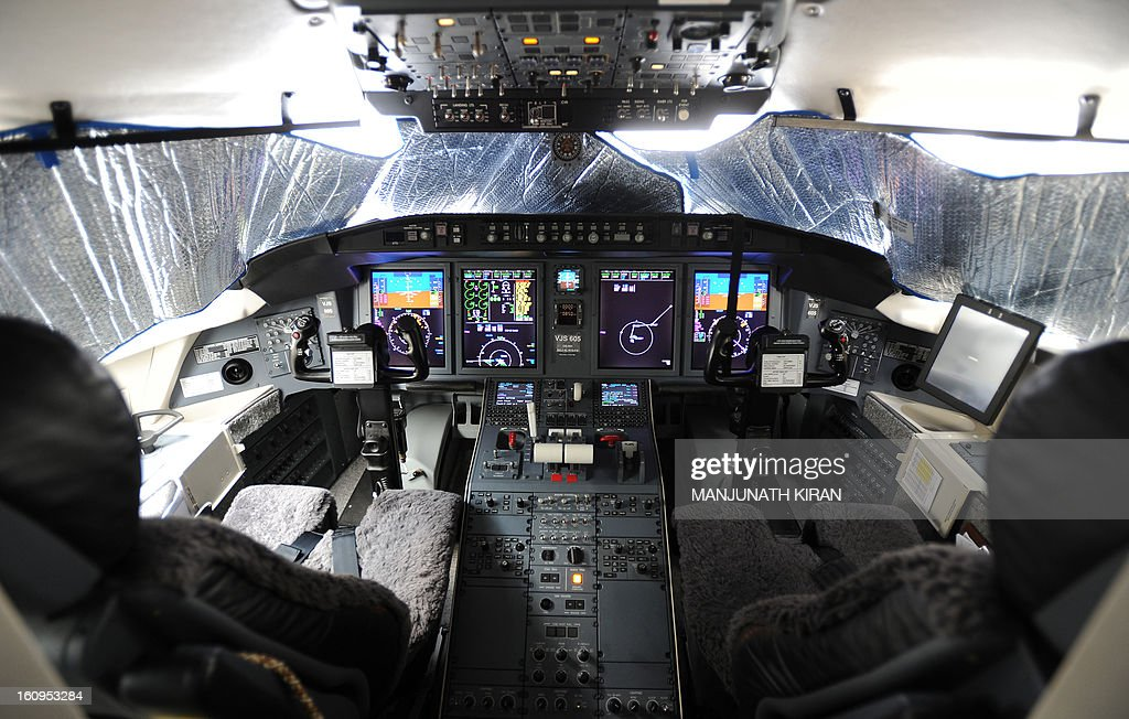 The cockpit of the Bombardier Private Jet is pictured at the static display on the third day of the 9th edition of the Aero India 2013 at Yelahanka Air Force station in Bangalore on February 8, 2013. India, the world's leading importer of weaponry, opened one of Asia's biggest aviation trade shows February 6 with Western suppliers eyeing lucrative deals and a Chinese delegation attending for the first time. AFP/Manjunath KIRAN