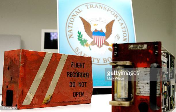 The cockpit voice recorder and the flight data recorder that was retrieved from Comair Flight 5191 are shown at the National Transportation Safety...