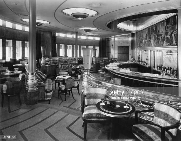 The cocktail bar and observation lounge of the Cunard White Star liner Queen Mary The bar is made of Macassar ebony with a mural by Alfred R Thomson...