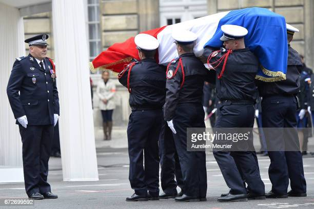 The coffin arrives at the National tribute to fallen French Policeman Xavier Jugele on April 25 2017 in Paris France French Police Officer Xavier...