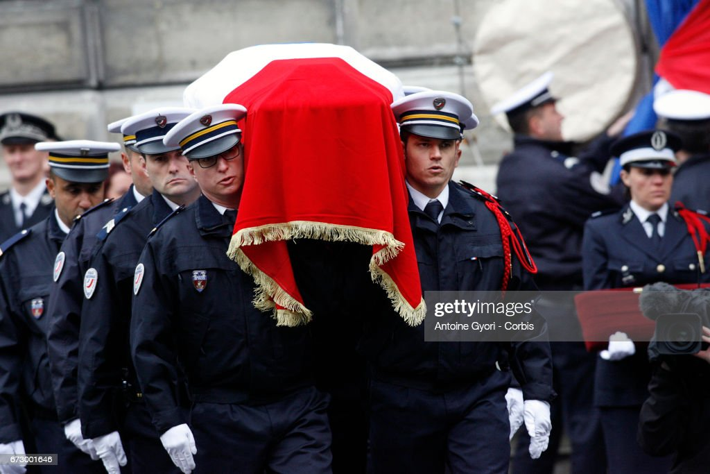 The coffin arrives at the National tribute to fallen French Policeman Xavier Jugele on April 25, 2017 in Paris, France. French Police Officer Xavier Jugele, 37, was shot dead by a gunman on Thursday April 20, 2017 on Paris's Champs Elysees, a few days' prior to the French Presidential elections.