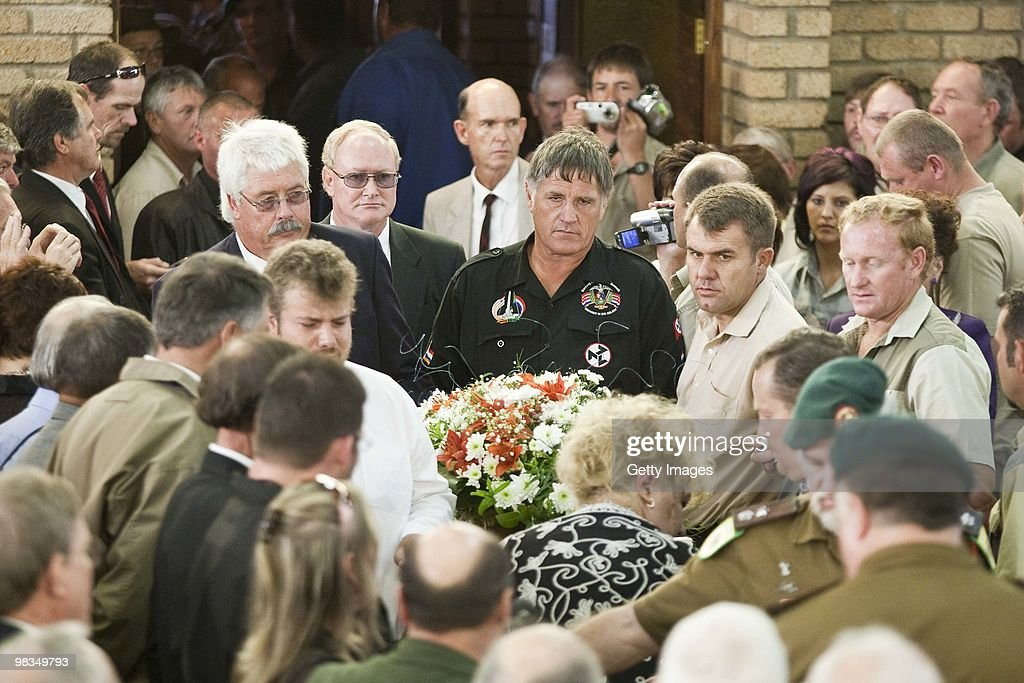 The coffin arrives for the funeral of Eugene Terre'Blanche, the late leader of Afrikaner Resistance Movement (AWB), on April 9, 2010 in Ventersdorp, South Africa. Some 3,000 people attended the funeral of the white supremacist who was murdered last Saturday at his farm. Two of Terrblanche's employees have been charged with his murder. Andries TerreBlanche is the brother of the late AWB leader.