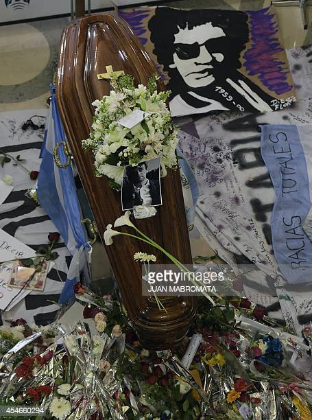The coffin bearing the remains of the late Argentine artist Gustavo Cerati is seen during his funeral at the Legislative building in Buenos Aires on...