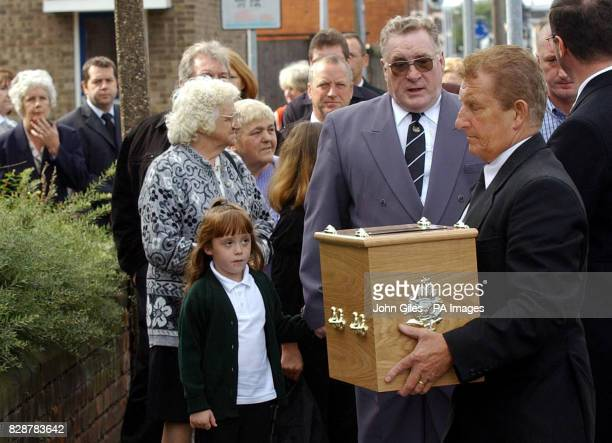 The coffin carrying Stanley Collier a fisherman from Hull who lost his life when the trawler the Gaul sank in 1974 is carried past his son Ken for...