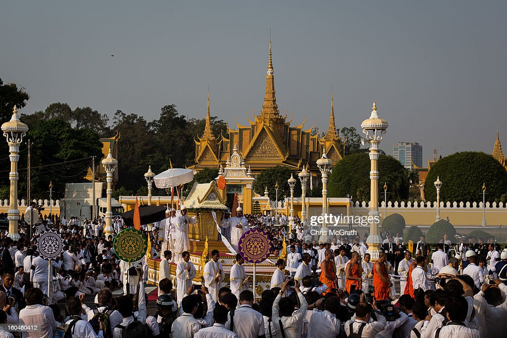 The coffin carrying the body of former King Norodom Sihanouk leaves the grounds of the Royal Palace before being paraded through the streets of Phnom Penh on February 1, 2013 in Phnom Penh, Cambodia. Over half a million mourners lined the streets to pay their respects during the funeral procession which finished at the crematorium where his funeral pyre will be lit by his wife and son on the 4th of February. King Norodom Sihanouk died of a heart attack last October in Beijing at the age of 89. For the past three months his body has been lying in state at the Royal Palace.