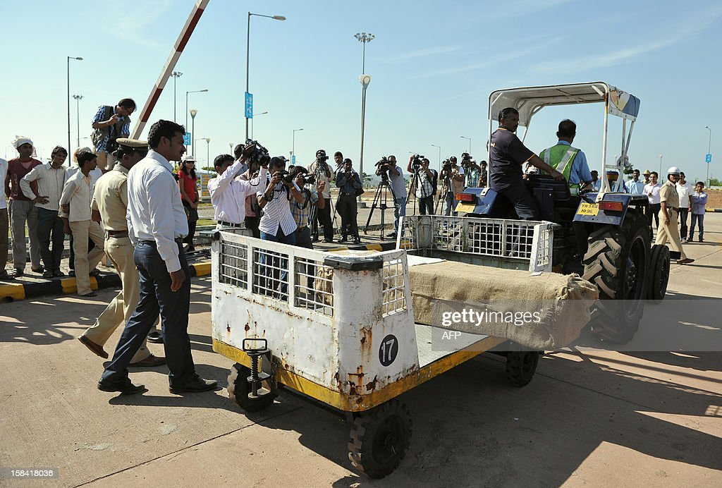 The coffin carrying the body of India-born nurse Jacintha Saldanha, 46, is brought out of the Bajpe Airport in Mangalore on December 16, 2012. The body of Saldanha who was found hanged after taking a hoax call to the hospital treating Prince William's wife arrived in Mangalore following a memorial mass in London. AFP PHOTO/ Manjunath KIRAN