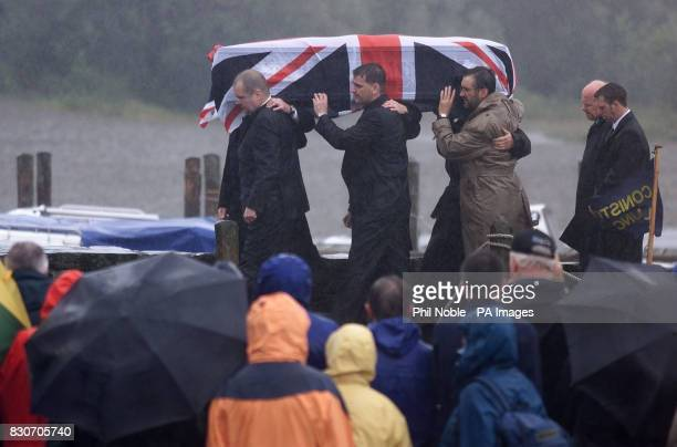 The coffin containing the remains of Sir Donald Campbell is carried ashore after being taken across Coniston Water by launch en route to his funeral...