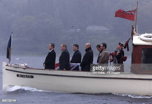 The coffin containing the remains of Sir Donald Campbell travels across Coniston Water by launch en route to his funeral service at St Andrews Church...