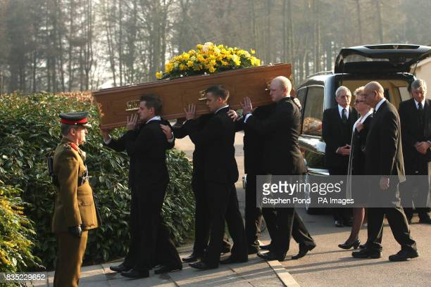 The coffin is carried from the hearse before the cremation of Rifleman Jamie Gunn after the funeral service at St Mary's Church in Monmouth Rifleman...