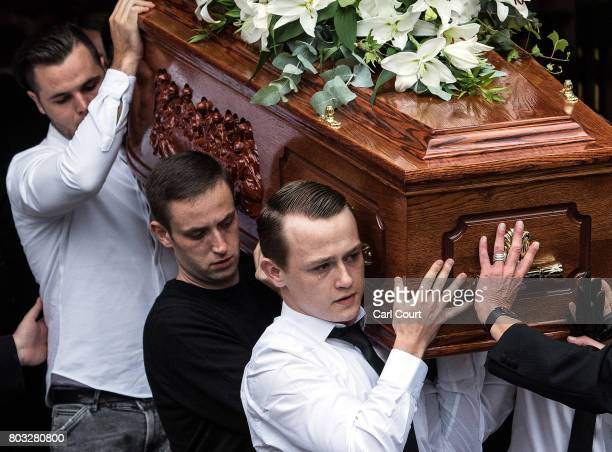 The coffin is carried out of a church after the funeral of one of the victims of the fire in Grenfell Tower on June 29 2017 in London England Tony...