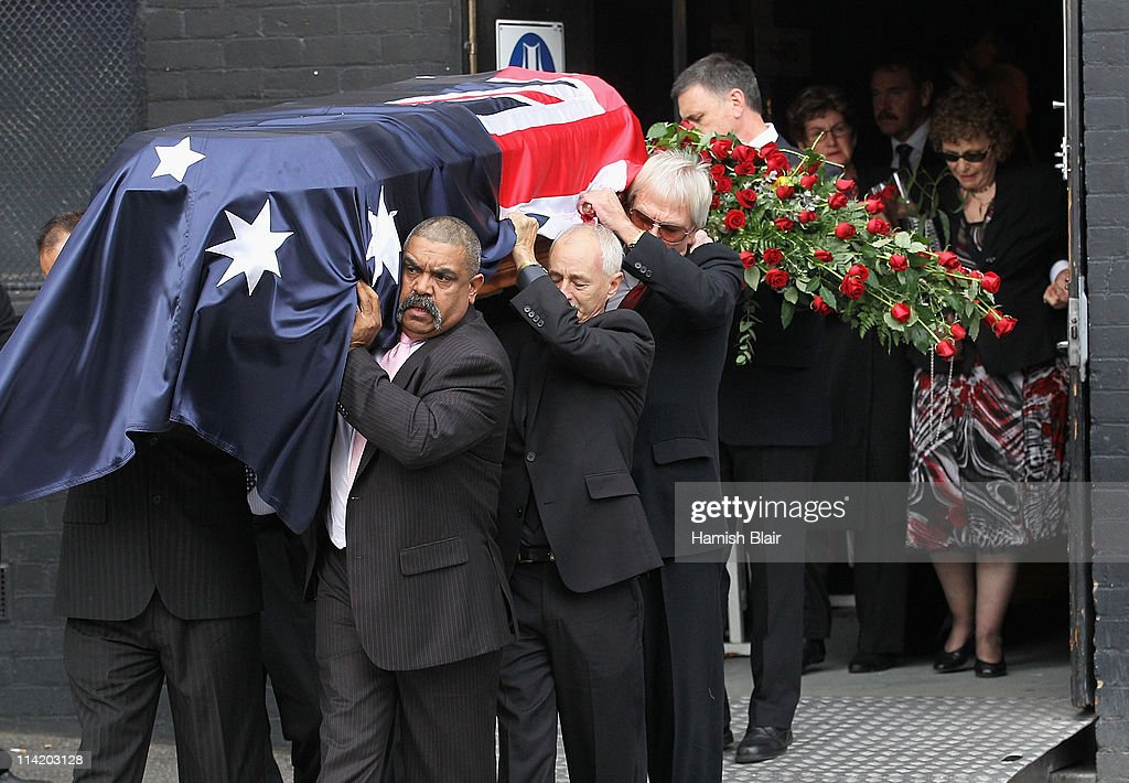 The coffin leaves Festival Hall followed by Jenny Rose (R) wife of Lionel Rose after the State Funeral held for former Australian boxer Lionel Rose at Festival Hall on May 16, 2011 in Melbourne, Australia. Rose, who passed away on May 8, was the first indigenous Australian to win a boxing world title and was the 1968 Australian of the Year.