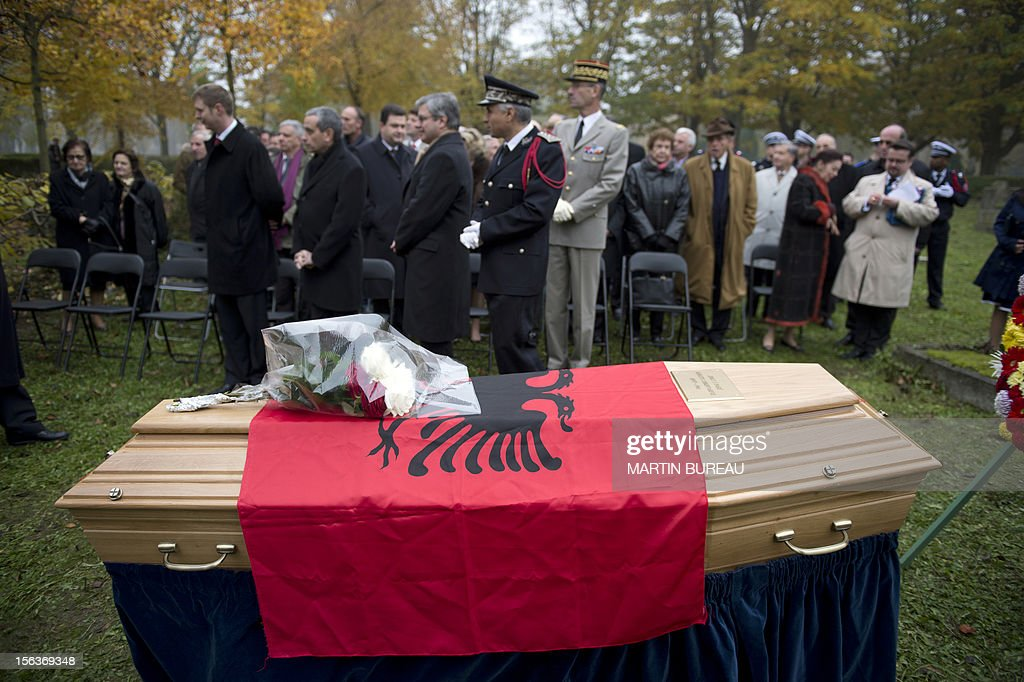 The coffin of Albanian King Zog I is carried after being exhumed at the cemetery of Thiais, on November 14, 2012. Albania will repatriate today the remains of its former self-proclaimed king Zog I from France, where he died in exile in 1961. An official burial will be held November 17 in the capital Tirana at a cemetery where other members of the royal family are already interred. BUREAU