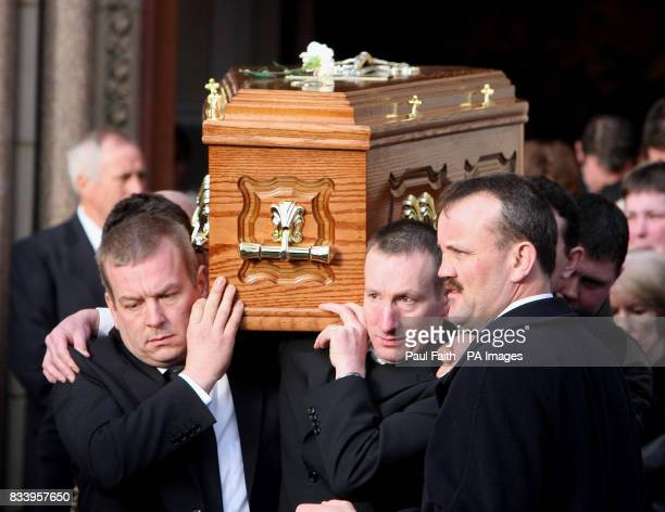 The coffin of Arthur McElhill is removed for burial after requiem mass at the Sacred Heart church in Omagh