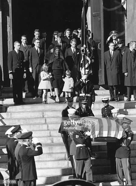 The coffin of assassinated American President John F Kennedy is carried down the steps at St Matthew's Cathedral Washington after the requiem mass...