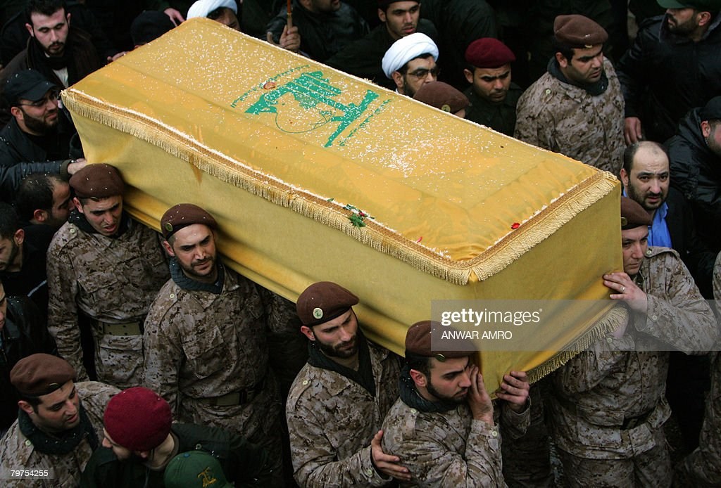 The coffin of assassinated Hezbollah commander Imad Mughnieh is carried by commanders during his funeral procession in Beirut's mainly Shiite Muslim...