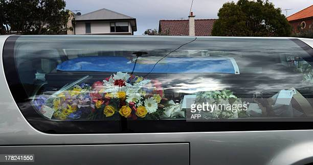 The coffin of Australian baseball player Chris Lane who was killed in the small Oklahoma town of Duncan in the US leaves St Therese's Parish...