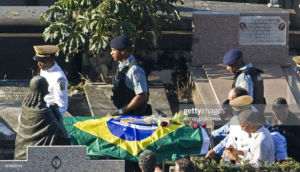 The coffin of Brazilian architect Oscar Niemeyer is carried at Sao Joao Batista cementery in Rio de Janeiro, Brazil on December 7, 2012. Niemeyer, the Brazilian icon who revolutionized modern architecture and designed much of the country's futuristic capital Brasilia, died at 104.