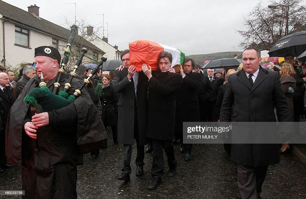 The coffin of convicted Old Bailey bomber Dolours Price is carried by her two sons Danny (CL) and Oscar (CR) to St Agnes Church in west Belfast, Northern Ireland, on January 28, 2013. Price, convicted for the infamous IRA bombing of the Old Bailey court in London in 1973, was found dead at her home in Ireland, her family said January 24, 2013. Price was one of a number of high-profile IRA members who gave accounts of their past to Boston College in a series of interviews as part of the US university's oral history of the Northern Ireland conflict.