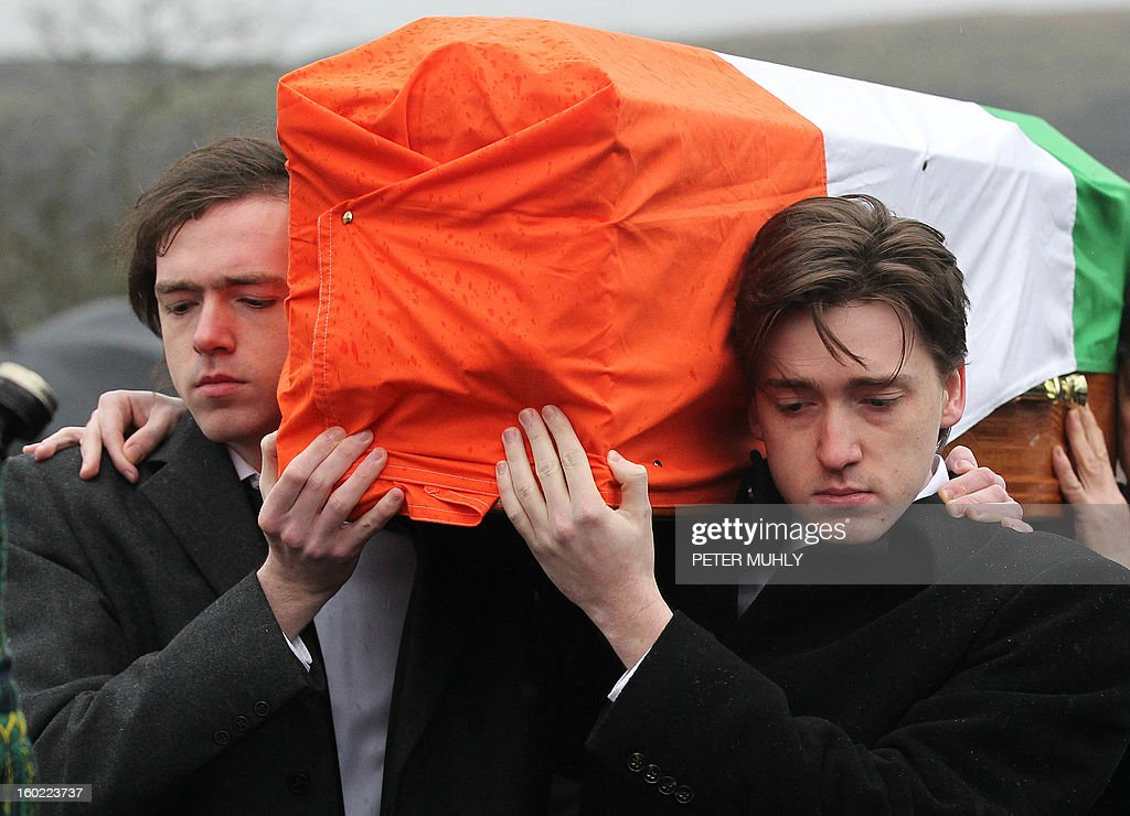 The coffin of convicted Old Bailey bomber Dolours Price is carried by her two sons Danny (L) and Oscar (R) to St Agnes Church in west Belfast, Northern Ireland, on January 28, 2013. Price, convicted for the infamous IRA bombing of the Old Bailey court in London in 1973, was found dead at her home in Ireland, her family said January 24, 2013. Price was one of a number of high-profile IRA members who gave accounts of their past to Boston College in a series of interviews as part of the US university's oral history of the Northern Ireland conflict. AFP PHOTO / PETER MUHLY