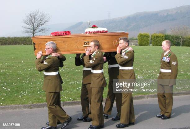 The coffin of Corporal Dean John is carried at his funeral service in Margam Crematorium Port Talbot South Wales