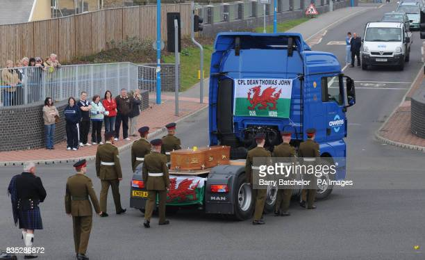 The coffin of Corporal Dean John travels through Port Talbot on the back of a lorry on the way to the funeral service