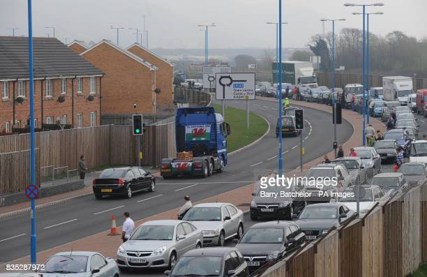 The coffin of Corporal Dean John travels through Port Talbot on the back of a lorry