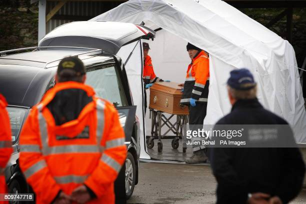 The coffin of crew member Attia Shaban is taken from the Garda Tent after being identified as the first body to be recovered as the search continues...