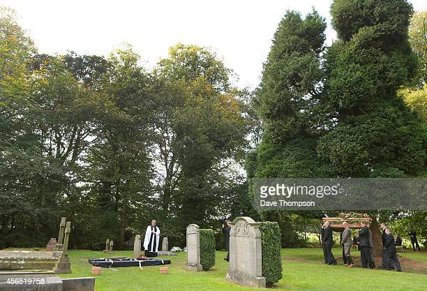 The coffin of Deborah Dowager Duchess of Devonshire is carried to its burial plot at St Peter's Church Edensor on October 2 2014 in Chatsworth...
