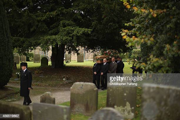 The coffin of Deborah Dowager Duchess of Devonshire is carried to St Peters Church Edensor on October 2 2014 in Chatsworth England Deborah Cavendish...