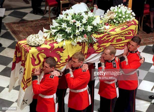 The coffin of Diana Princess of Wales is carried inside Westminster Abbey for her funeral service 06 September following her tragic death in a Paris...