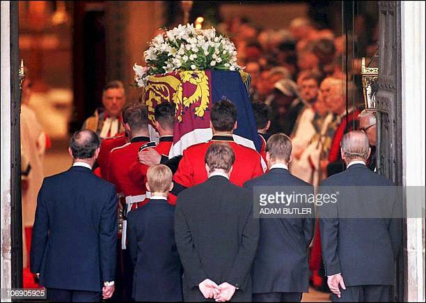 The coffin of Diana Princess of Wales is carried into Westminster Abbey by the bearer party of Welsh Guardsmen for her funeral 06 September followed...
