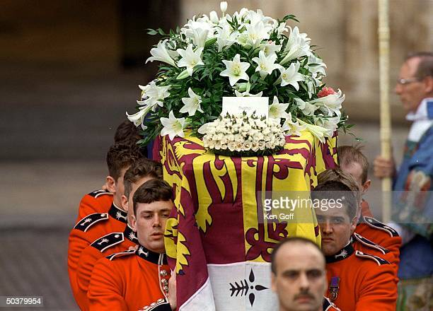 The coffin of Diana Princess of Wales leaving Westminster Abbey w floral wreaths from her sons and others including card from Prince Harry reading...