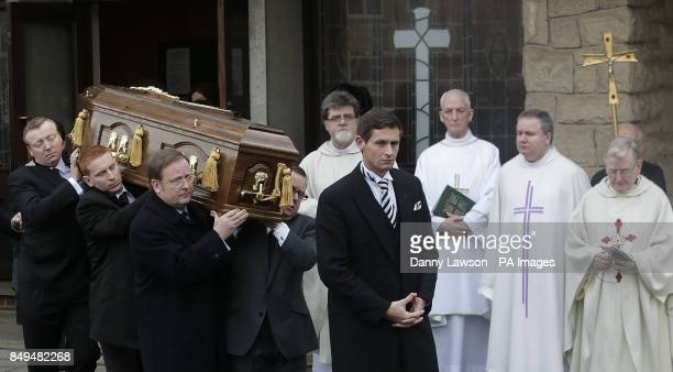 The coffin of former Celtic assistant manager Sean Fallon is carried outside Christ the King Church in Glasgow Scotland during his funeral
