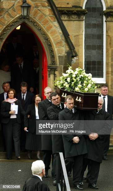 The coffin of former Celtic Newcastle United and Scotland player Ronnie Simpson is carried from St Ninians Church in Edinburgh The surviving members...