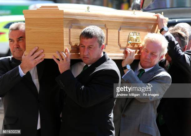 The coffin of former Hibernian and Scotland football player Lawrie Reilly is carried into St Andrew's and St George's West Church in Edinburgh by...