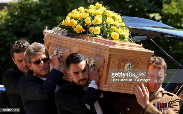 The coffin of former Tennis player Elena Baltacha is carried into St Johns Church in Ipswich Suffolk for her funeral service