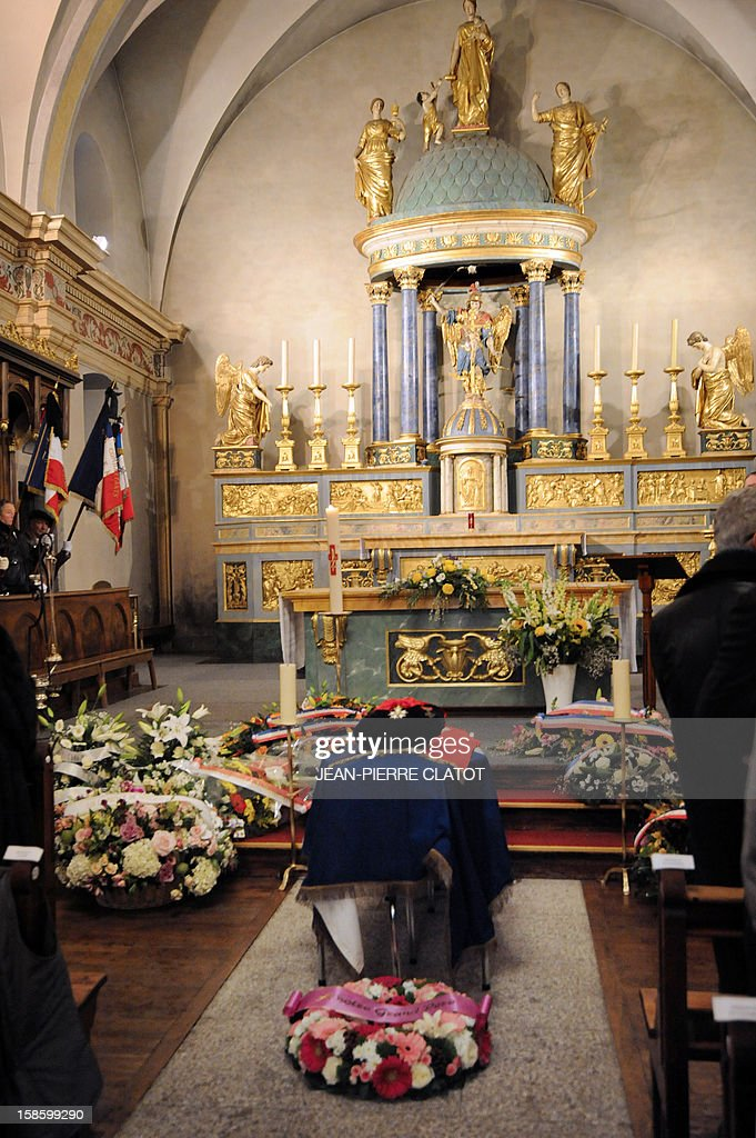 The coffin of French climber Maurice Herzog is pictured during his funeral ceremony, on December 20, 2012 at the Saint-Michel church in Chamonix, French Alps. Maurice Herzog, the French climber who conquered Annapurna in the first recorded ascent of a peak above 8,000 metres, has died at the age of 93, on December 13.