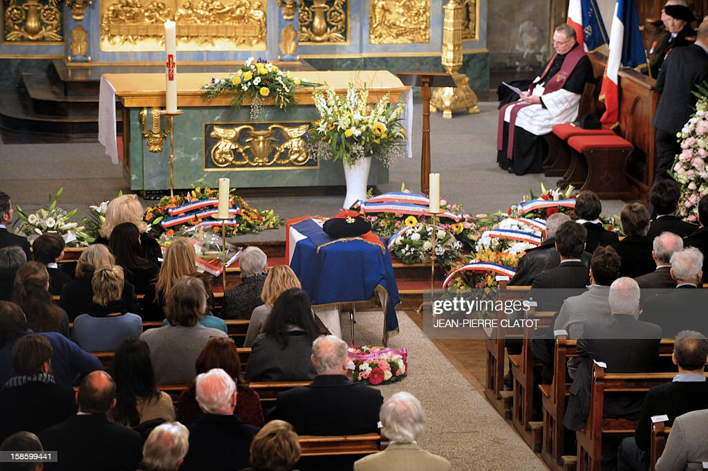 The coffin of French climber Maurice Herzog (C) is pictured during his funeral ceremony attended by his relatives and friends, on December 20, 2012 at the Saint-Michel church in Chamonix, French Alps. Maurice Herzog, the French climber who conquered Annapurna in the first recorded ascent of a peak above 8,000 metres, has died at the age of 93, on December 13.