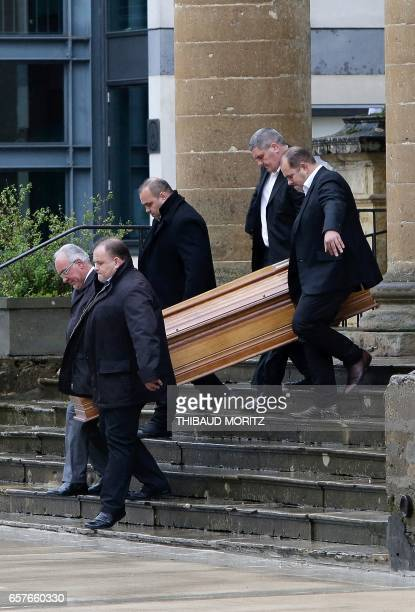 The coffin of French Socialist Party's politician Henri Emmanuelli is carried towards the hearse on March 25 2017 during his funeral at the Madeleine...