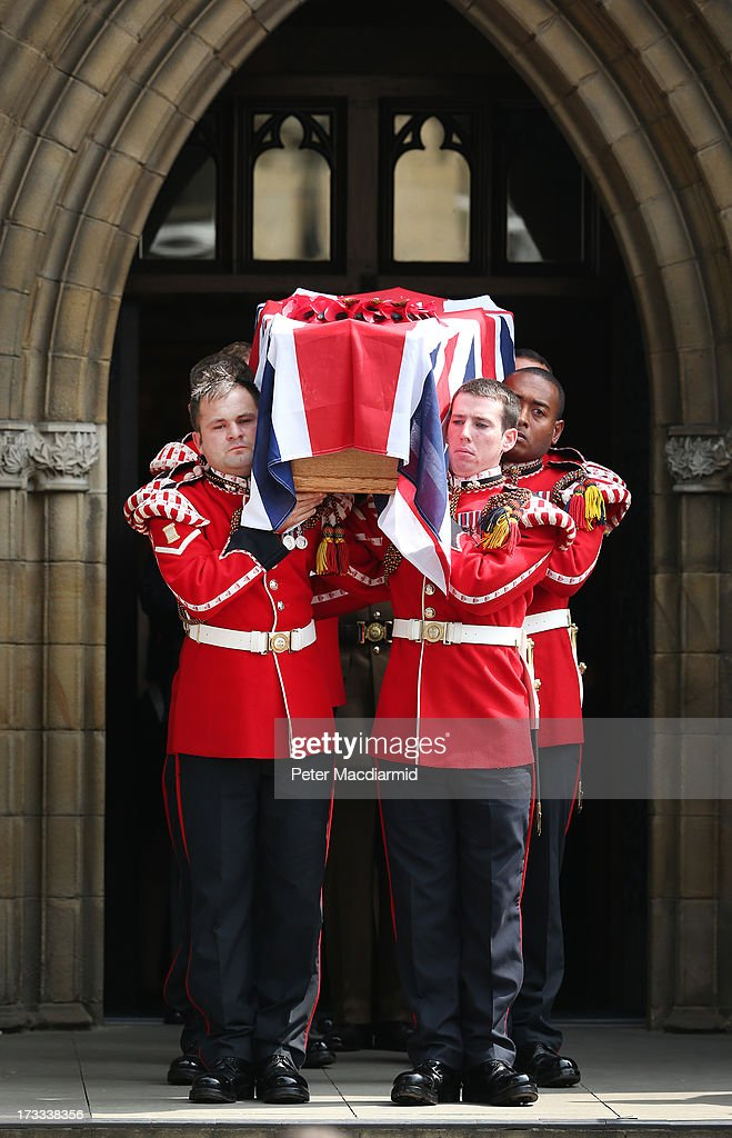 The coffin of Fusilier Lee Rigby leaves Bury Parish Church after his military funeral on July 12 2013 in Bury Greater Manchester England The Royal...