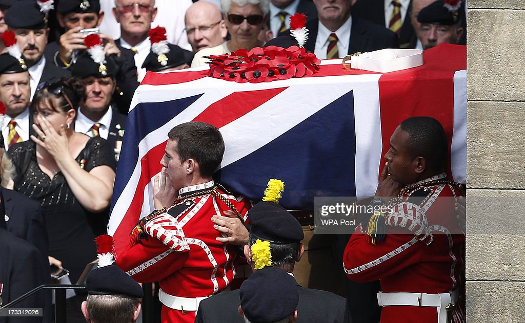 The coffin of Fusilier Lee Rigby leaves Bury Parish Church following his military funeral on July 12 2013 in Bury Greater Manchester England The...
