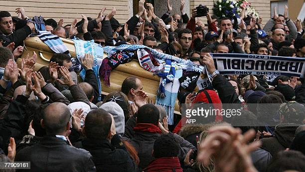 The coffin of Gabriele Sandri leaves the Pio X church after the funeral ceremony in downtown Rome 14 November 2007 Gabriele Sandri a 28yearold Lazio...