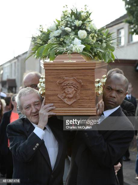 The coffin of Gerry Conlon is carried by an emotional Paddy Hill a member of the socalled Birmingham Six into St Peter's Cathedral for a requiem mass...