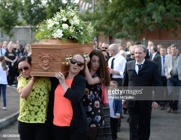 The coffin of Gerry Conlon is carried by family members into St Peter's Cathedral for a requiem mass on June 28 2014 in Belfast Northern Ireland...