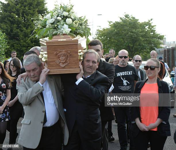 The coffin of Gerry Conlon is carried from his home in Blackwater Way watched by a friend wearing a tshirt bearing Conlon's speech on the day he was...