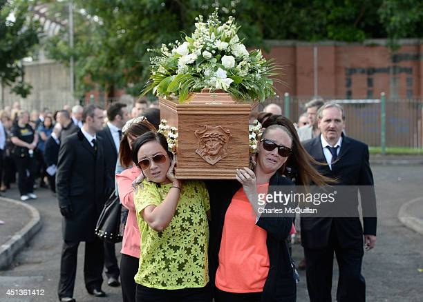 The coffin of Gerry Conlon is carried from his home in Blackwater Way by distraught family members to St Peter's Cathedral for a requiem mass on June...