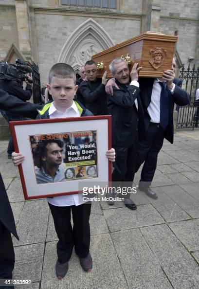 The coffin of Gerry Conlon is carried from St Peter's Cathedral after a requiem mass by fellow Guildford Four member Paddy Armstrong and Paddy Hill...