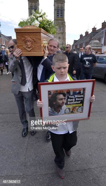 The coffin of Gerry Conlon is carried from St Peter's Cathedral after a requiem mass by fellow Guildford Four members Paddy Armstrong as family...